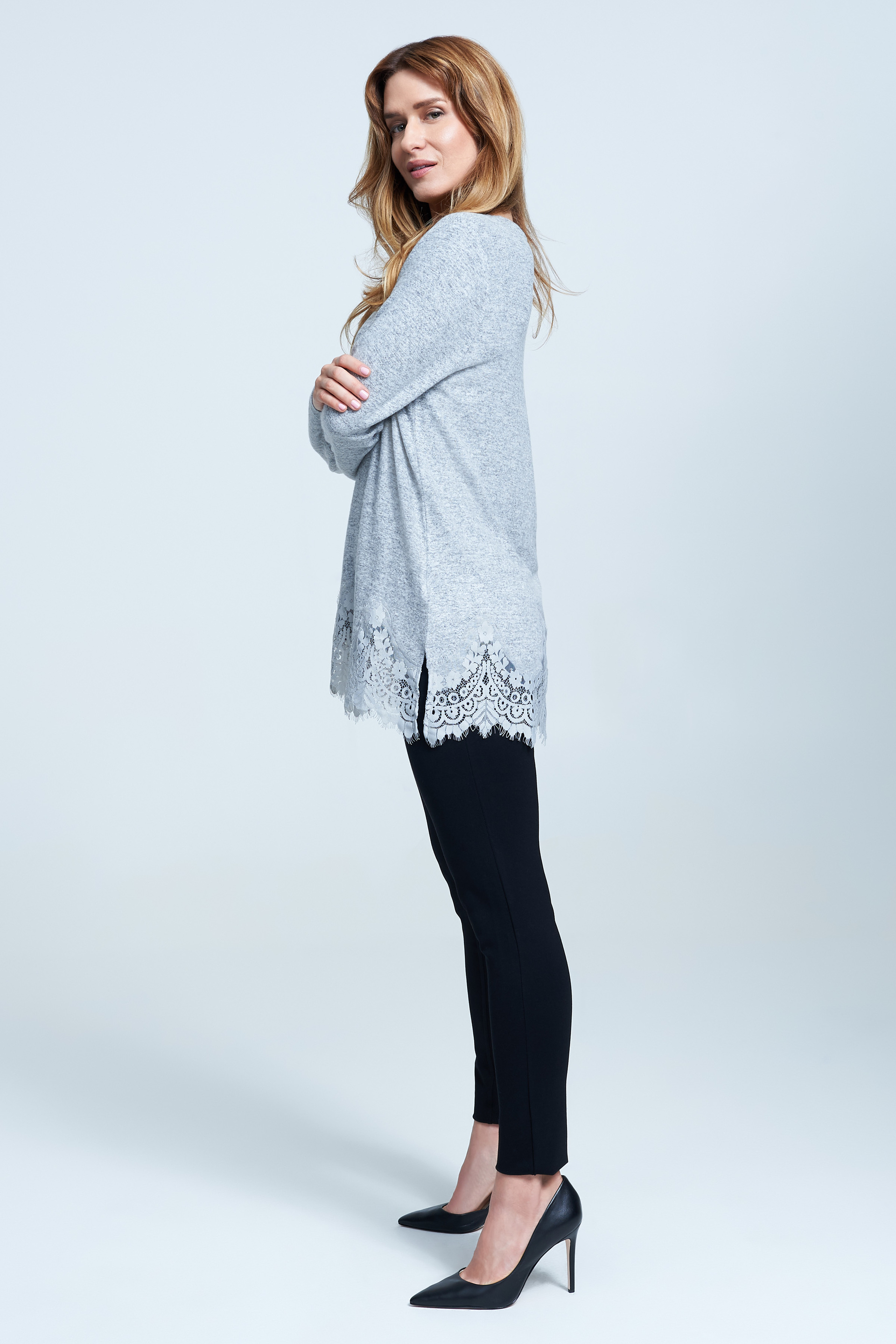 Seven7 Jeans Knit Top with Lace Trim <p>Scalloped lace sweeps along the hem of this thigh-skimming knit top featuring three-quarter sleeves and split sides.</p>