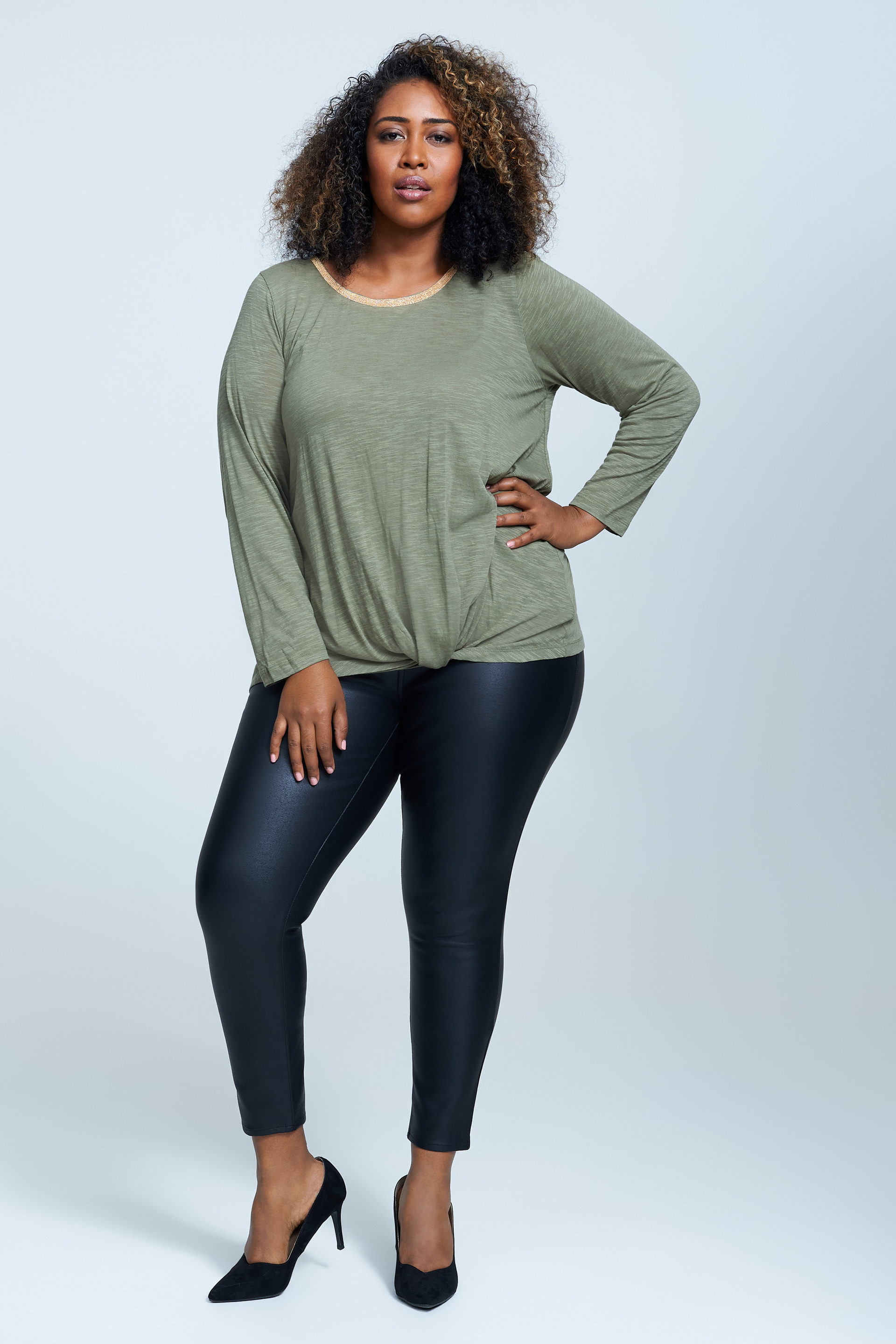 Seven7 Jeans Neck Trimmed Top  <p>Contrast ball trim accents the graceful scoopneck styling of this long-sleeve knit top finished with a draped hemline.</p>