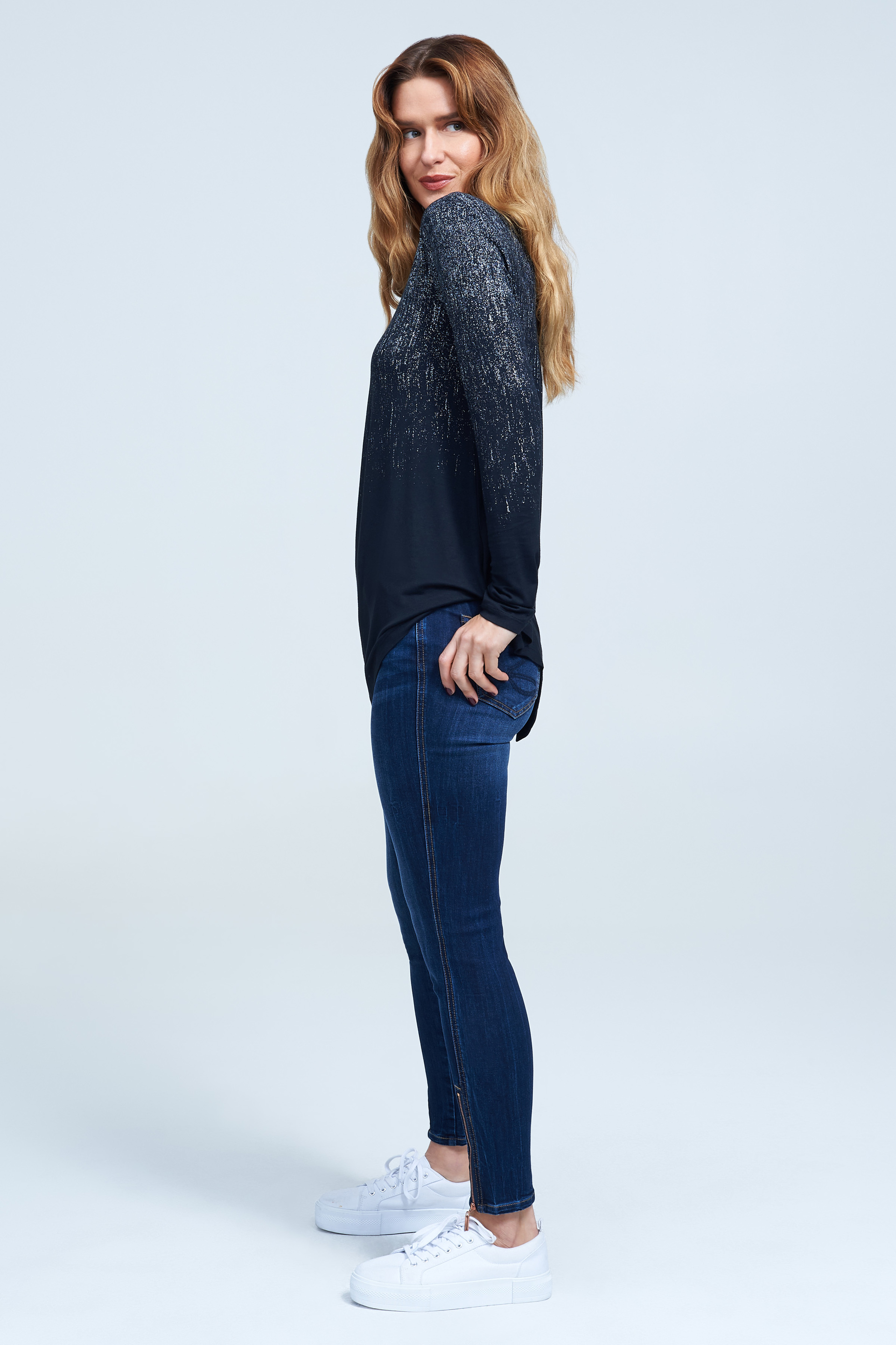 Seven7 Jeans Asymmetrical Hem Top with Foil Detail <p>Metallic silver foil catches the light on this long-sleeve knit top styled with long sleeves and a pointed hemline.</p>