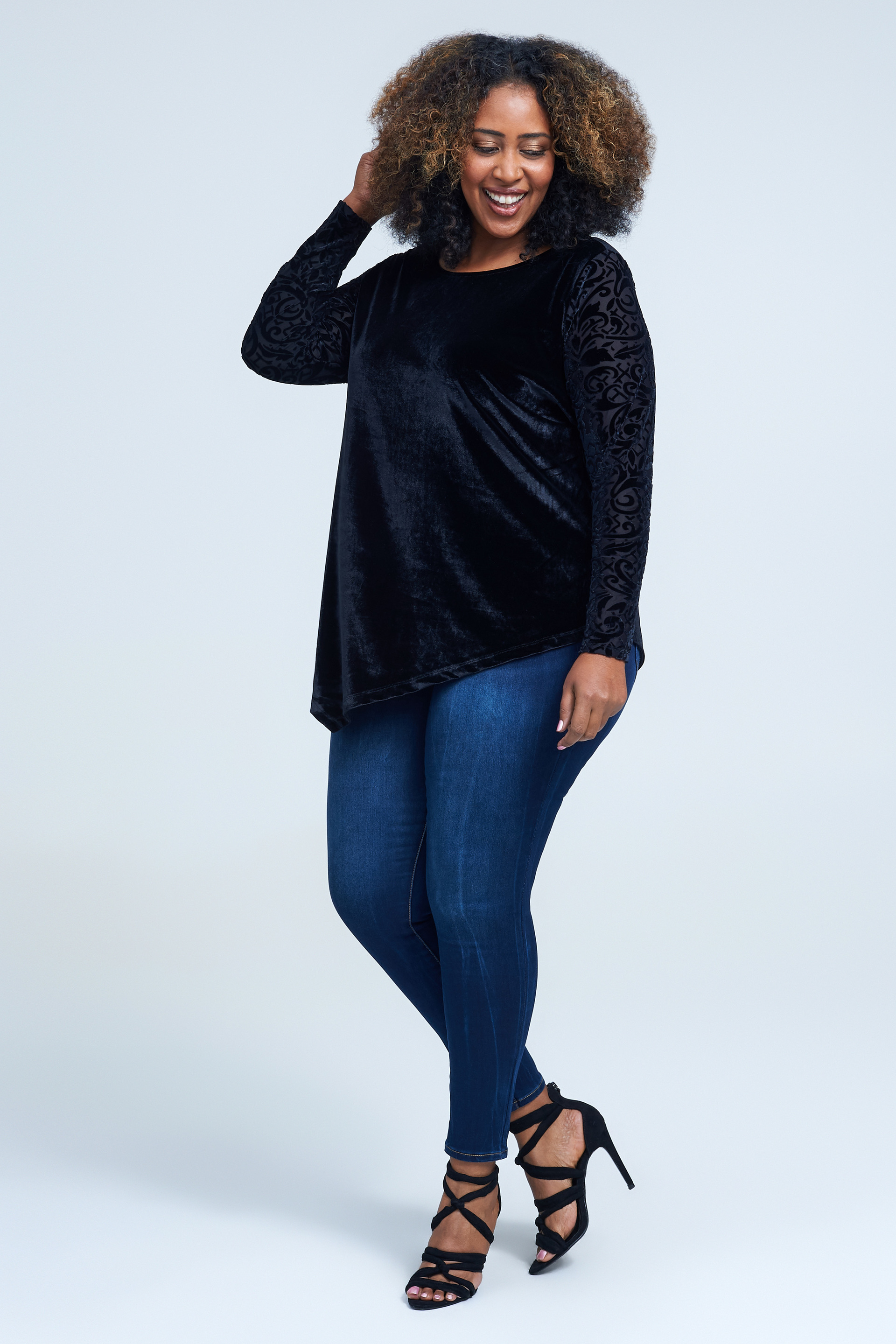 Seven7 Jeans Velour Burn Out Top  <p>Soft, lustrous velour brings a luxe feel to this relaxed scoopneck top featuring an asymmetrical hemline and long sleeves with a swirling burnout pattern.</p>